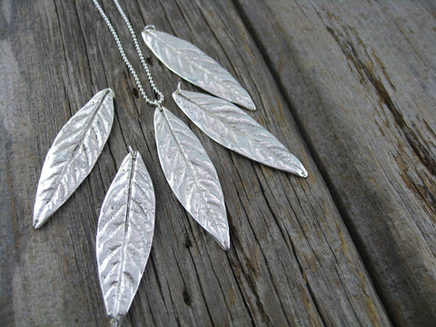 kerra family tree leaves - shiny mystery leaves cast from heirloom family sterling silver cutlery.