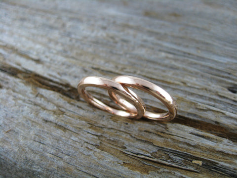 ema wedding rings - 2 14K rose gold bands that will sit on either side of her engagement ring.