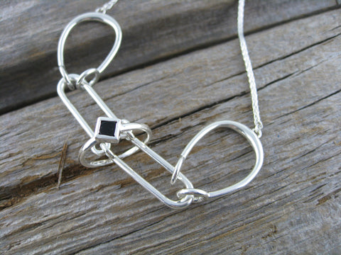 "sterling silver puzzle necklace with ""hidden"" engagement ring for that moment the time is just right."