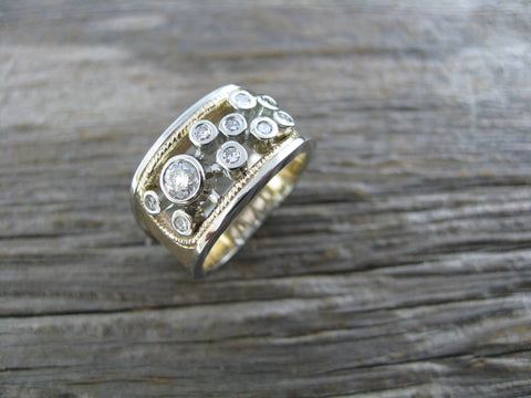 This ring uses heirloom gold and stones seen in the small pic to create this new ring for new fingers. Karen's knuckles were giving her issues so we made this fresh ring out of her old rings for her so she could still enjoy her wedding set.