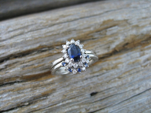 14K palladium white gold with both heirloom and matching diamonds and sapphires.