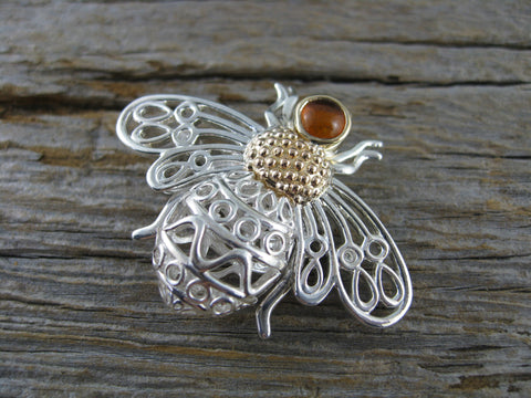 brenna bee brooch/pendant -  a brooch in sterling silver, 14k rose gold and 14k yellow gold with an amber set in the head. Can be worn as either a brooch or a pendant.