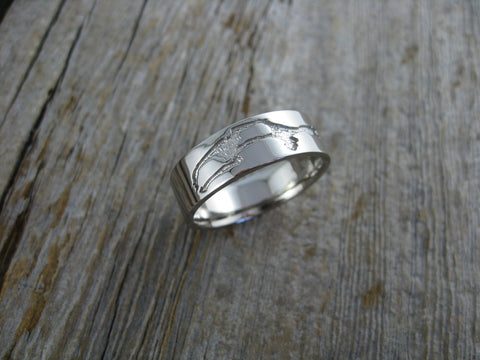 dennis wedding band - 14K palladium white gold with a custom map of pebble beach golf course where they first fell in love.