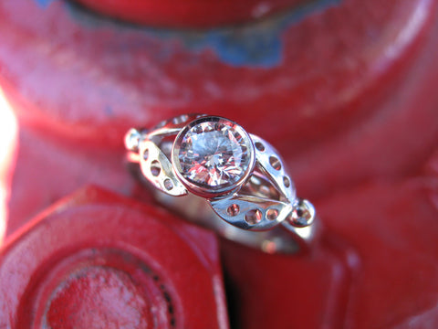 <p>christianne ring: 14k palladium white gold and an ideal round brilliant canadian diamond</p>