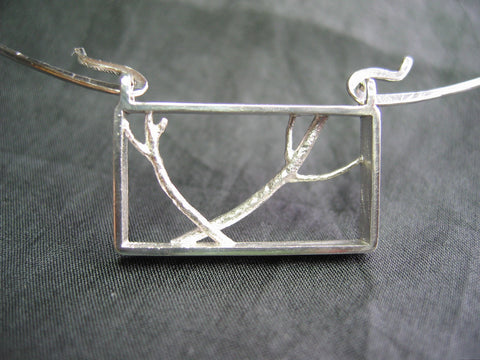 <p> christina necklace: sterling silver hand fabricated branches in a sterling silver frame</p>