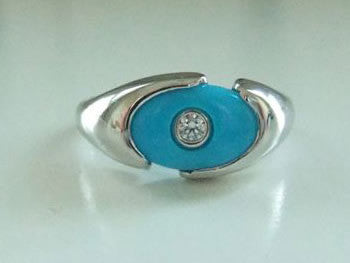 <p>elizabeth ring: turquoise with a round diamond set in a platinum ring</p>