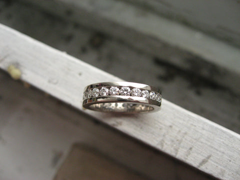 <p>eternity band: 18k palladium white gold and channel set diamonds</p>