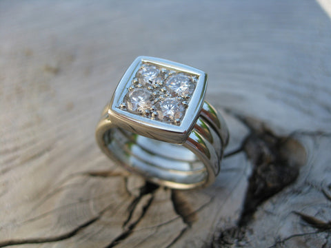 <p>jj's ring: this is a fresh version in 14k white gold and 4 round diamonds reused from heirloom rings.</p>