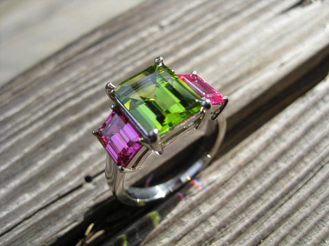 <p>jessica cocktail ring: peridot and pink sapphires set in 18k palladium white gold</p>