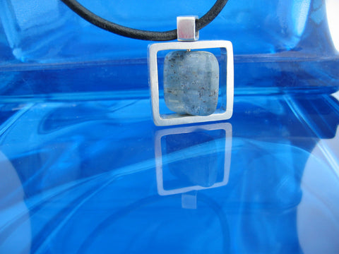 <p>sterling silver spinning pendant with apatite that also spins</p>