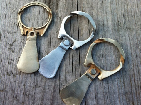 <p> tabs for the seeker: 14k yellow gold and sterling silver pull tabs custom made for ryan</p>