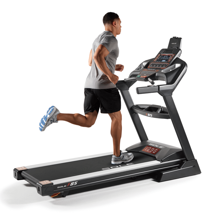 Man running on Sole F85 Treadmill
