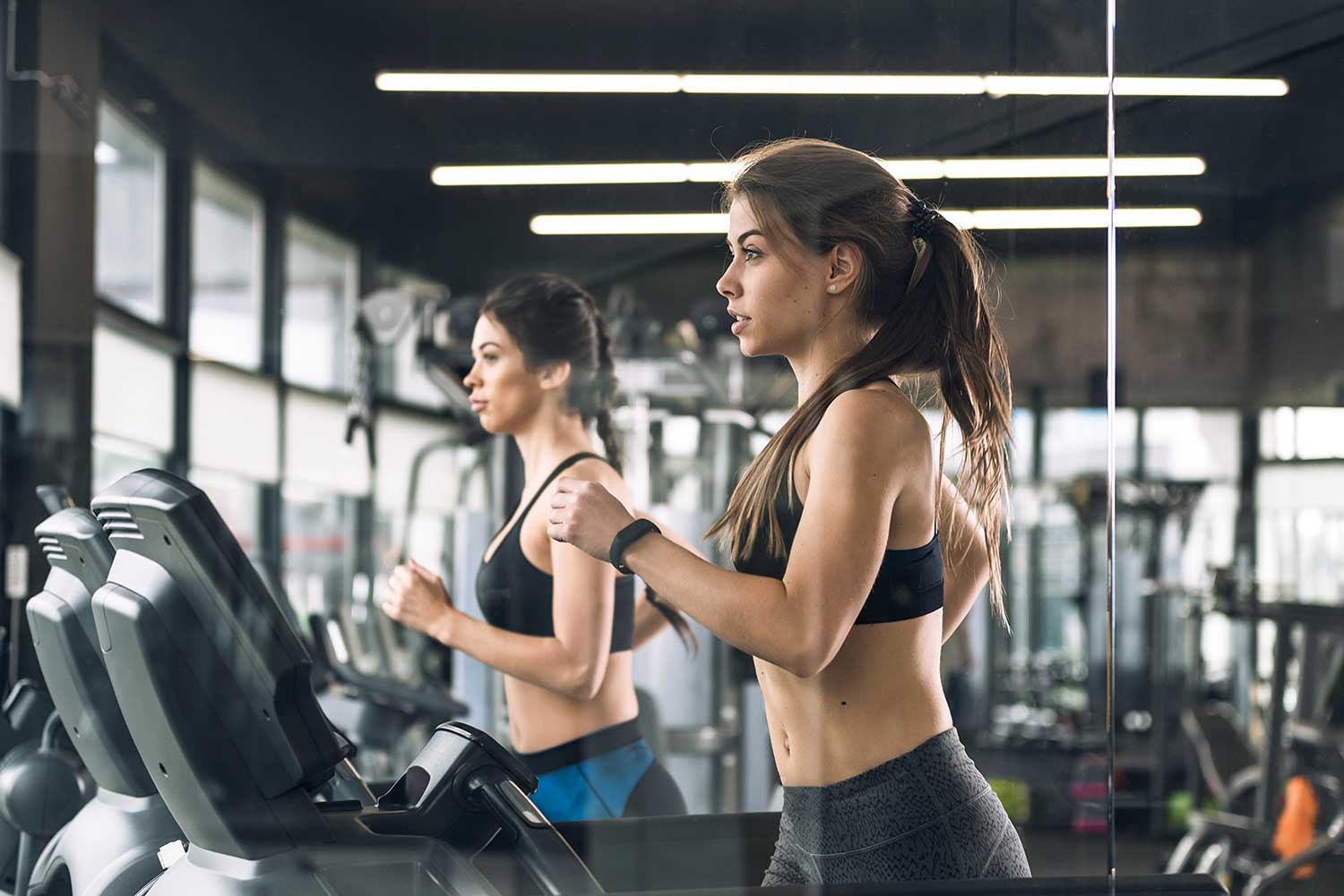 Girls doing a HIIT workout on a treadmill