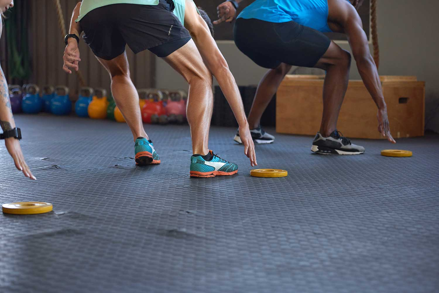 People performing HIIT training exercises
