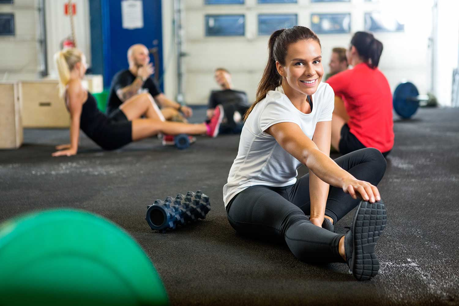 Lady stretching after an intense interval training workout
