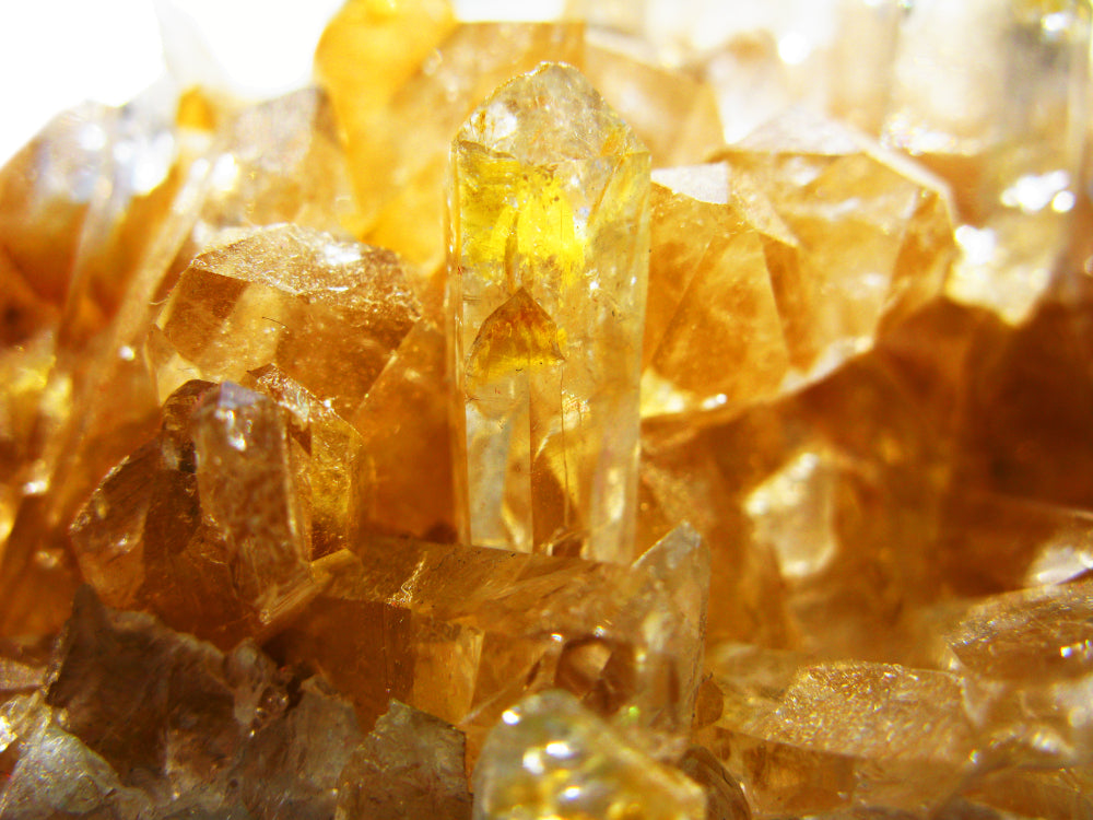 Zoomed in collection of raw citrine crystals.