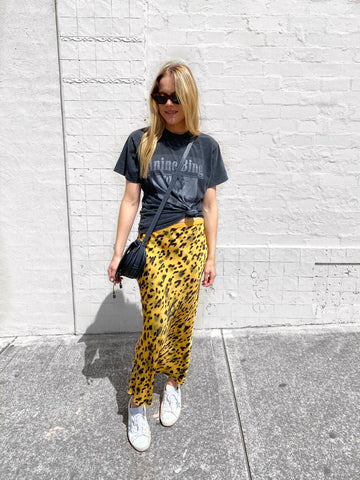 Pairing a slip skirt with a logo tee.