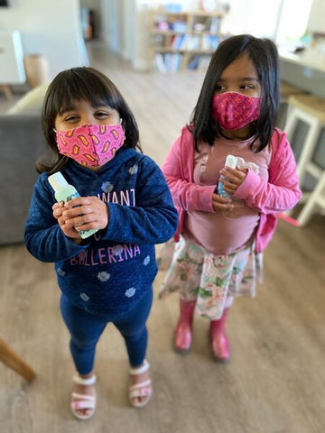 sisters wearing masks for school