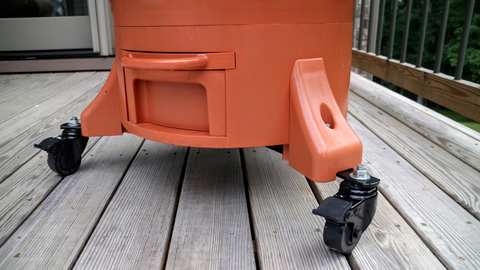 closeup of the base of a Garden Tower® with the wheel caster kit attached