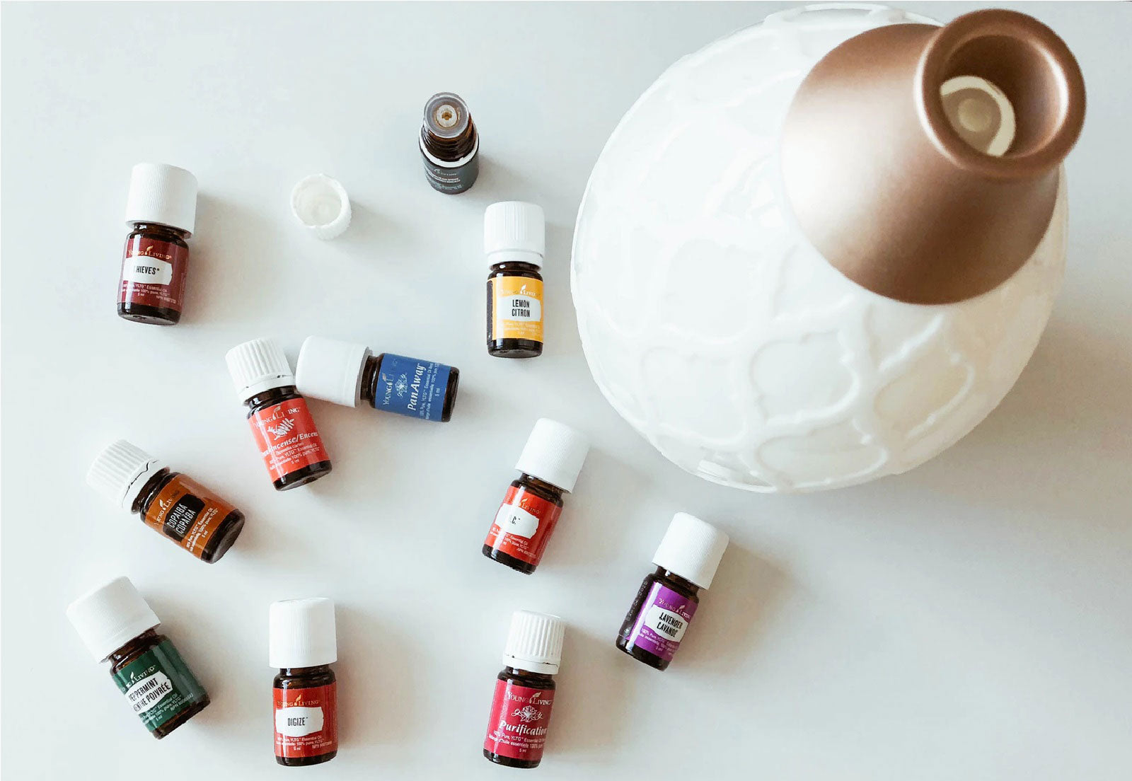 Many essential oil bottles and an oil diffuser