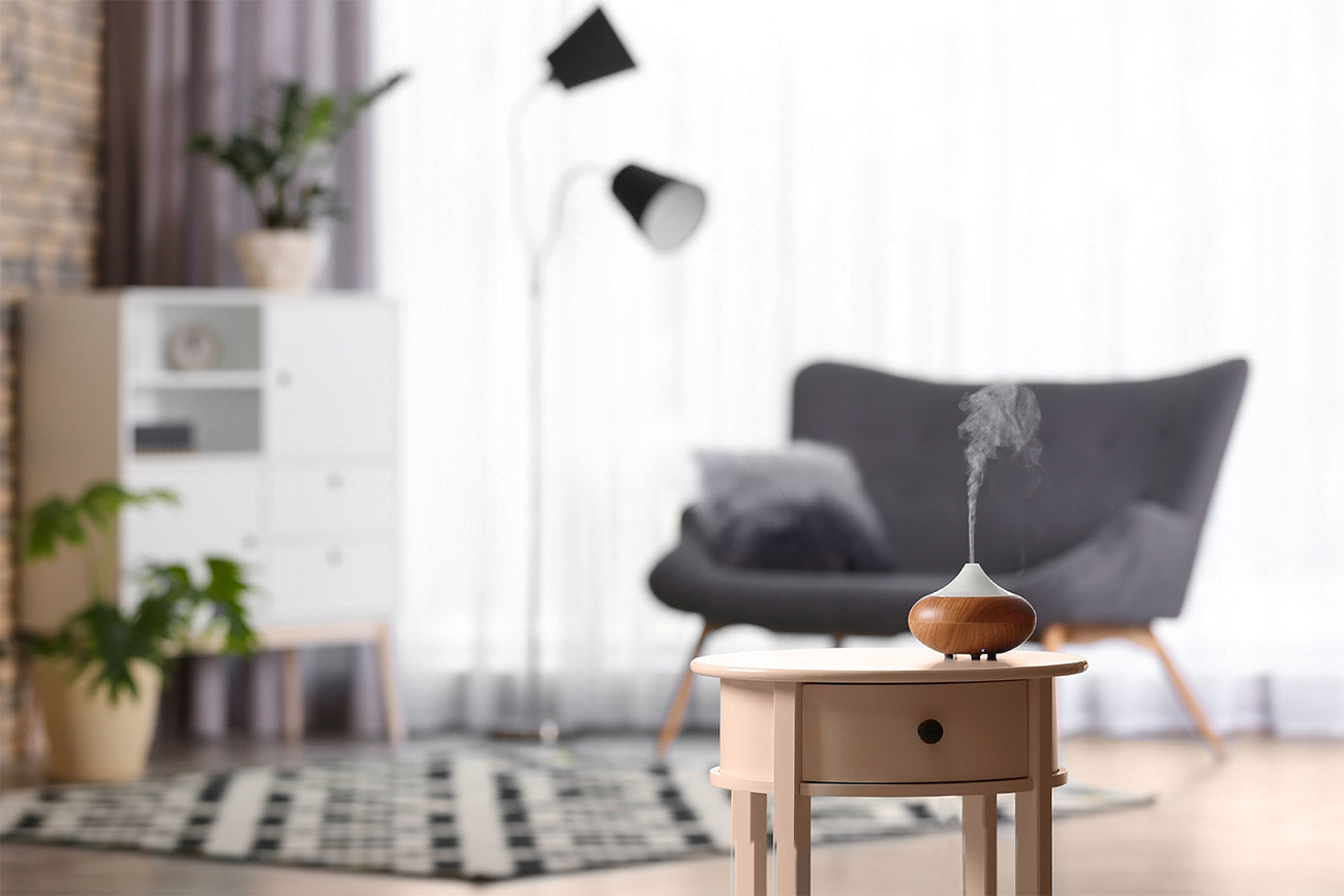 Aromatherapy diffuser on table, perfect decoration. Air freshener