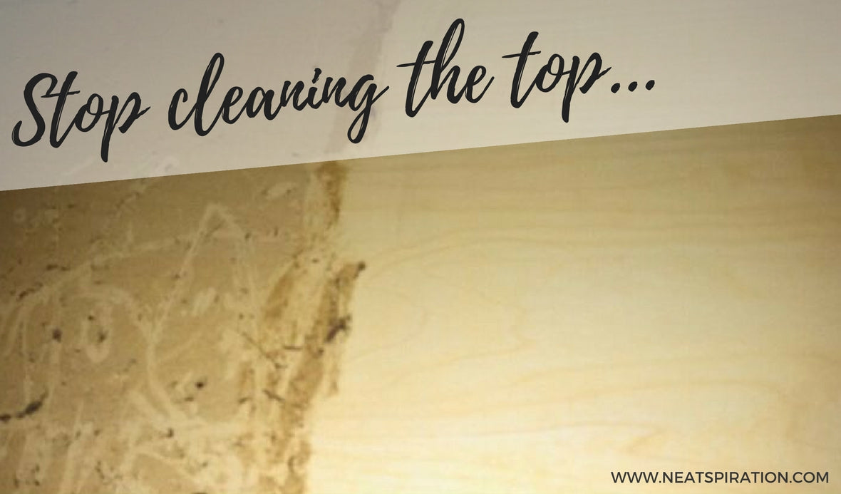 Why do the top of Kitchen Cabinets get sticky?