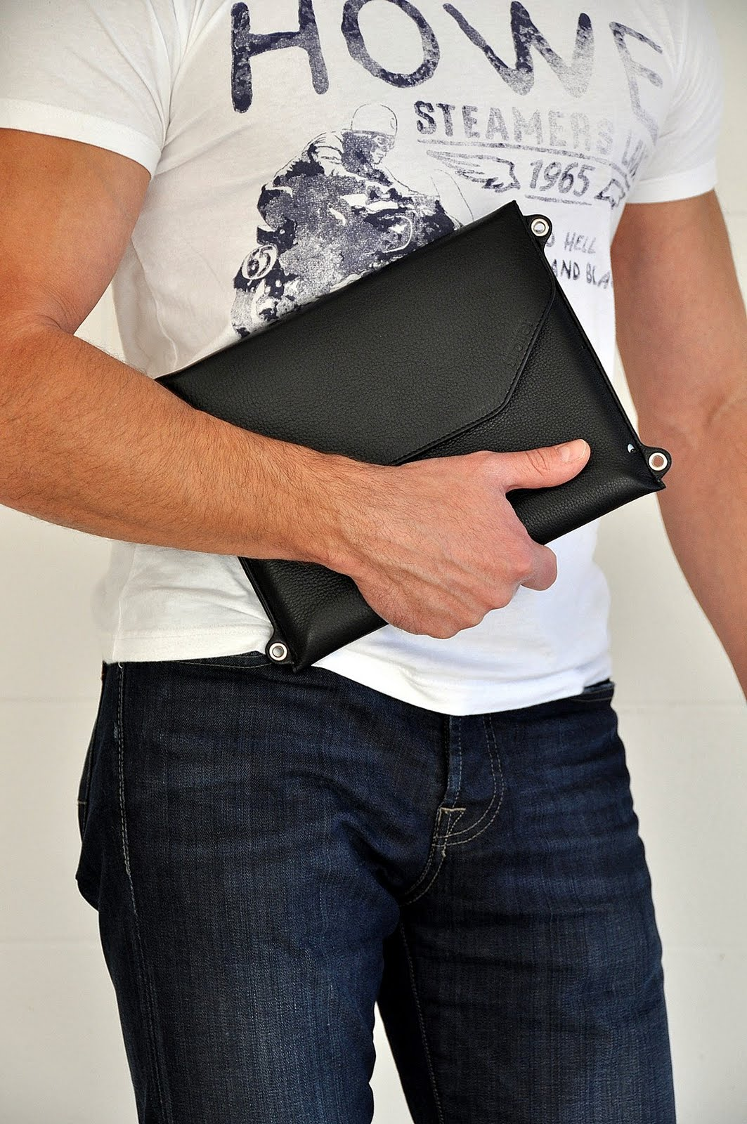 Without the strap Across is a slim portfolio case