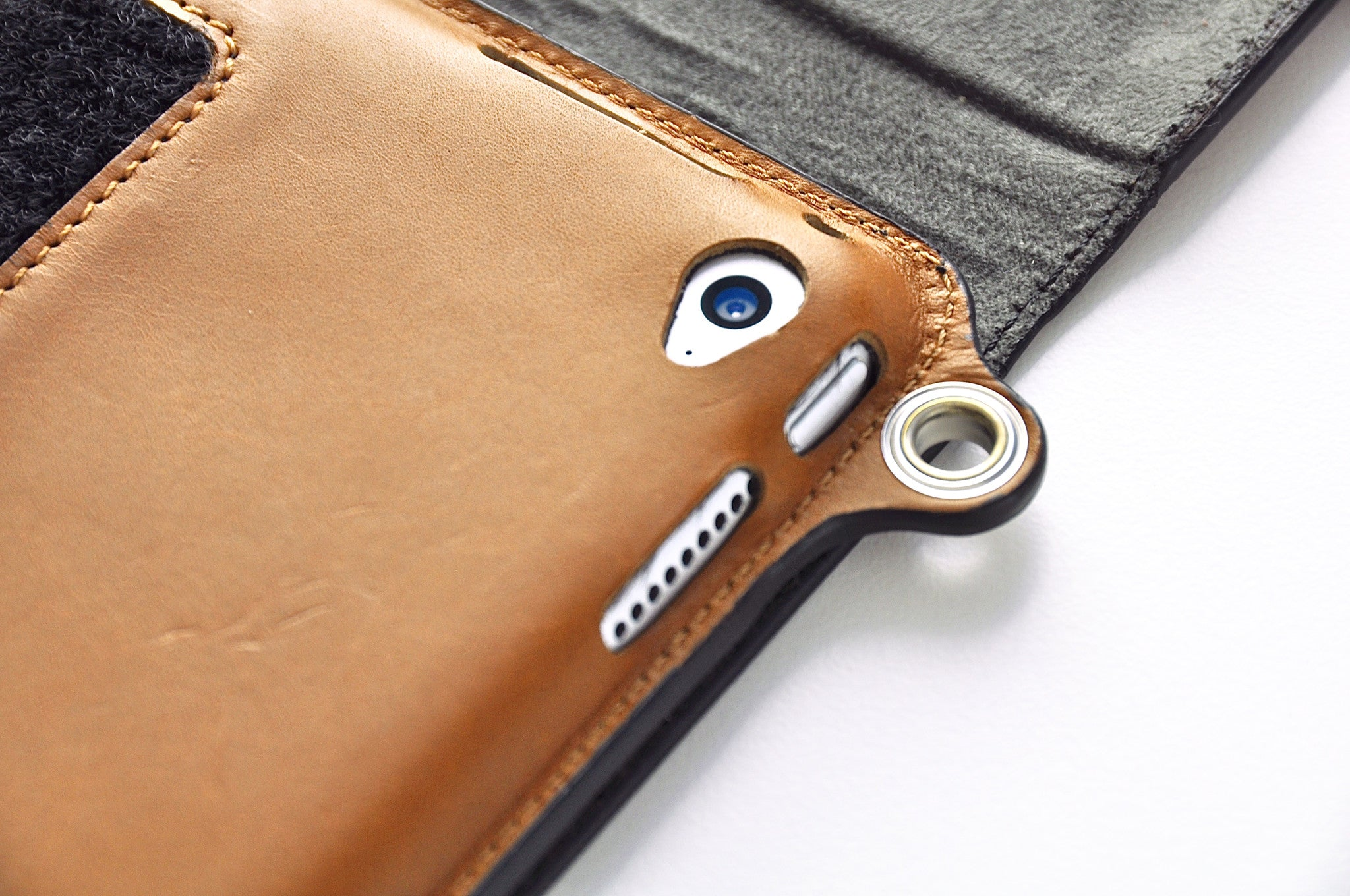 Camera lens is exposed for taking pictures when iPad case is in hands-free mode.