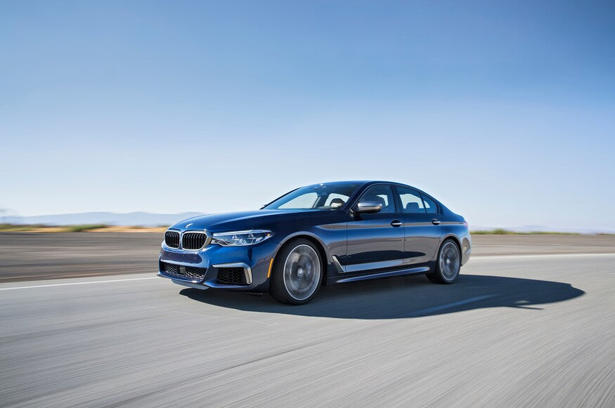 2018-BMW-M550i-xDrive-front-three-quarter-in-motion-clarksoff