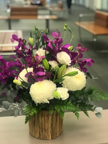 Purple mokara orchids mixed arrangement