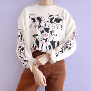 Hand printed off white cropped cow sweatshirt by Eva Stalinski