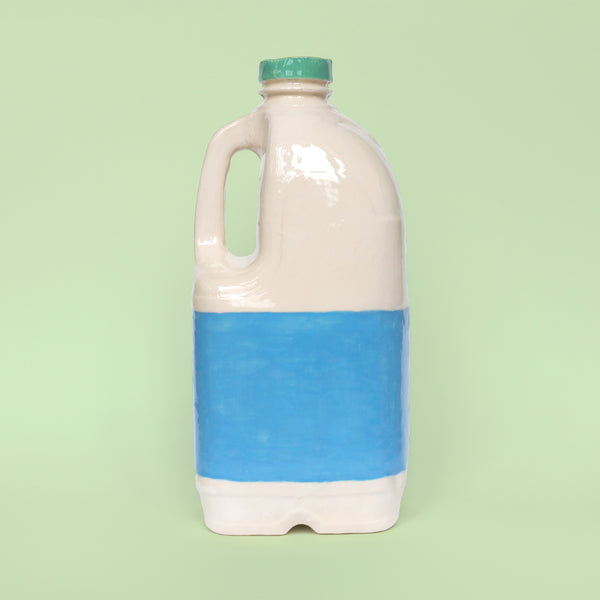 Back View of Anthropomorphic Ceramic Slipcast Vegan Plant Milk Jug by Illustrator Eva Stalinski Pictured on a Pale Green Background, 2020