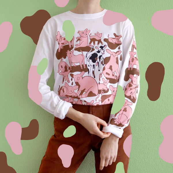 Imperfect White Hand Screen Printed Pigs in Mud Illustration Long Sleeve in Organic Cotton Made and Modeled by Print Maker Eva Stalinski Against Green Background with Colorful Splotches, 2020