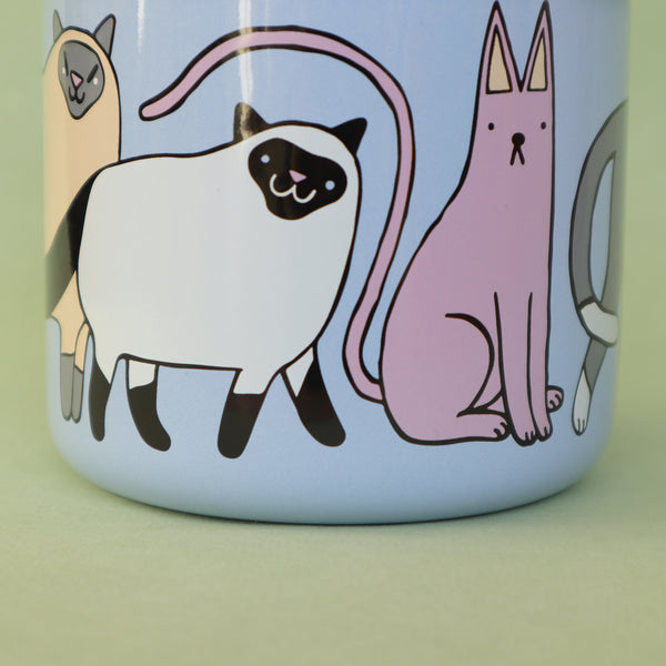 Close Up of Light Blue, Pink, Cream and Grey Enamel Cats Design Mug by Illustrator Eva Stalinski Featuring Sacred Birman, European British Shorthair, Kitten and Hairless Sphynx Cats, 2021. Produced by Family Owned Polish Factory Emalco Enamelware