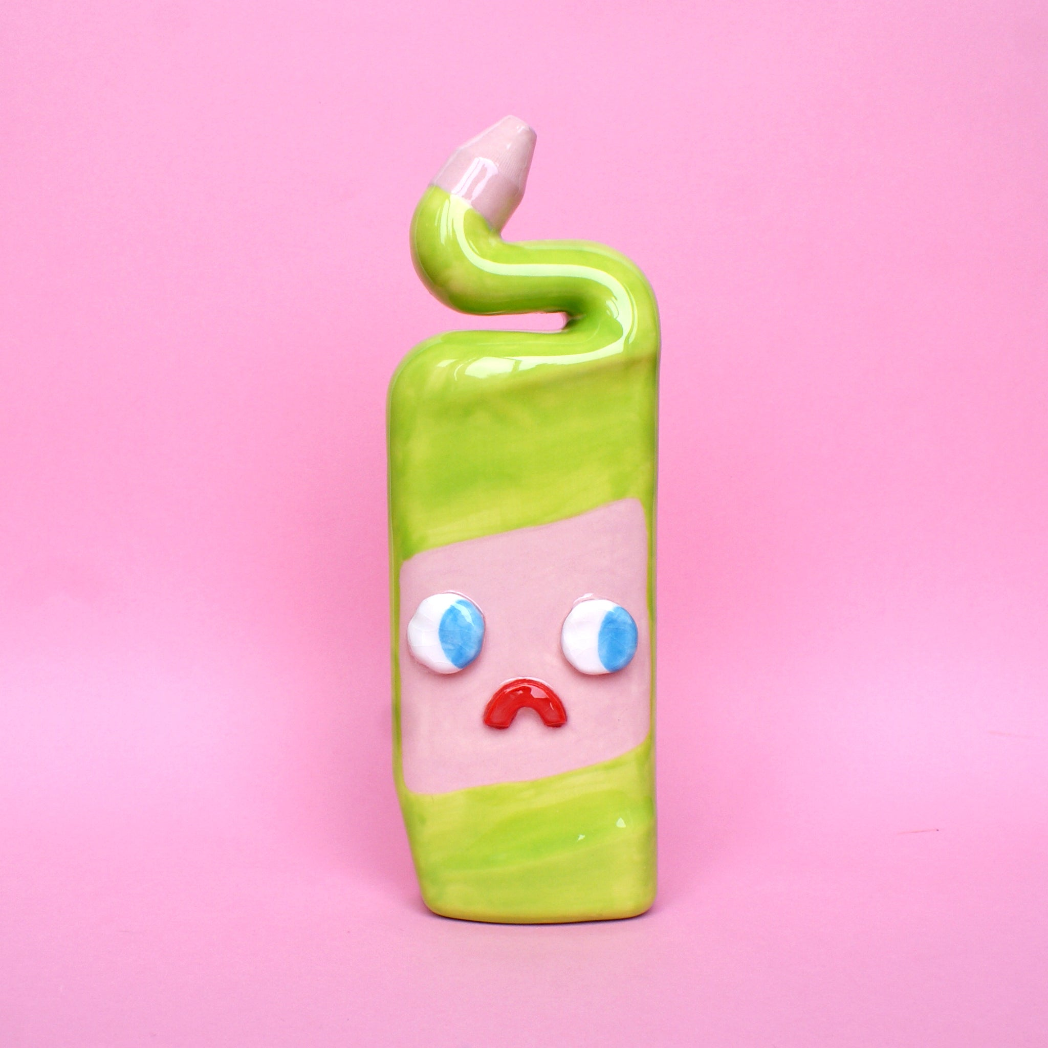 Green and Pink Ceramic Toilet Cleaner Bottle with Eyes