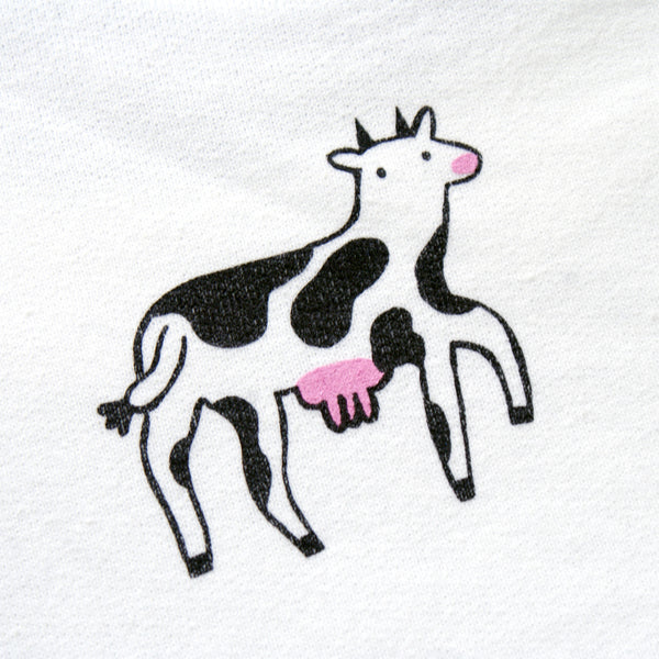 Screen printed white sweatshirt with happy cows illustration by Eva Stalinski model picture back print close up