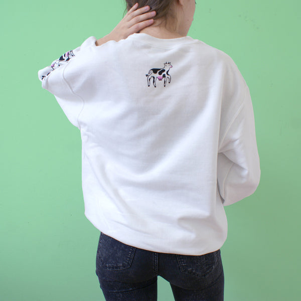 Screen printed white sweatshirt with happy cows illustration by Eva Stalinski model picture back print