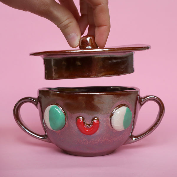 Shiny Copper Two Eared Slipcast Ceramic Mug with a Face by Illustrator Eva Stalinski, 2020. Anthropomorphic Copper Mug with Lid