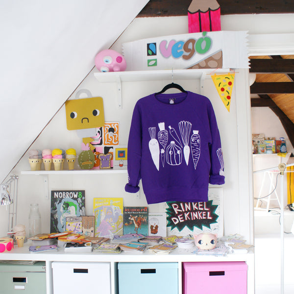 Imperfect PURPLE Veggie Sweater by illustrator Eva Stalinski Screen Printed Sweater hanging on hanger in studio picture
