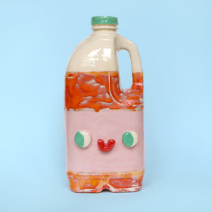 Anthropomorphic Ceramic Slipcast Orange Juice Jug by Illustrator Eva Stalinski Pictured on a Pale Blue Background, 2020
