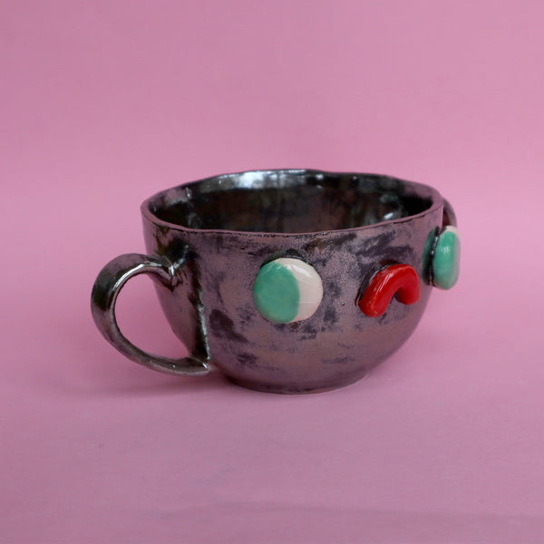 Side View of Pewter Silver Two Eared Slipcast Ceramic Mug with a Face by Illustrator Eva Stalinski, 2020. Anthropomorphic Silver Mug.