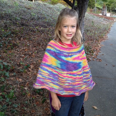 photo of girl in capelet