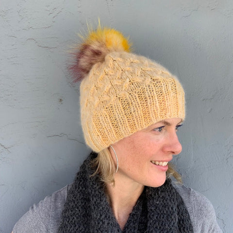 photo of person with yellow knit hat