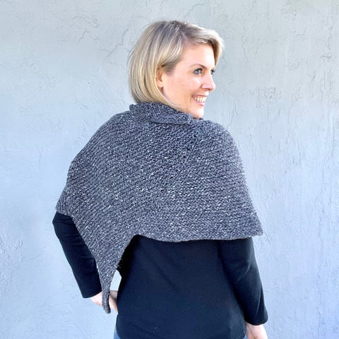 photo of woman in gray knit shawl