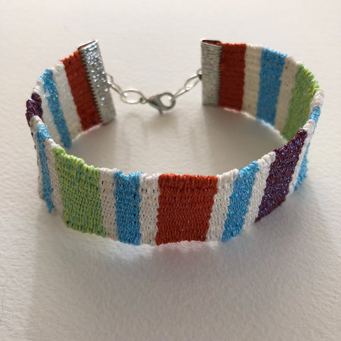 woven bracelet mini loom hardware and various colored threads by Kreinik