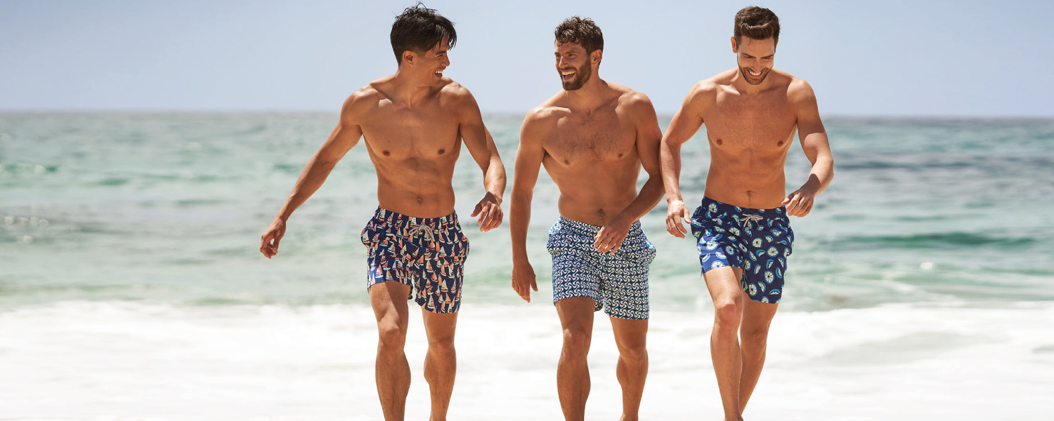 Mens Swim shorts and swimming trunks by Tom and Teddy The perfect beach boardshorts in matching father and son sizes and styles. Visually shown shorts on two men on the beach