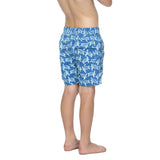 Boys blue swim trunks with a light blue turtle pattern