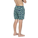 Boys dark blue swim shorts with a green turtle pattern