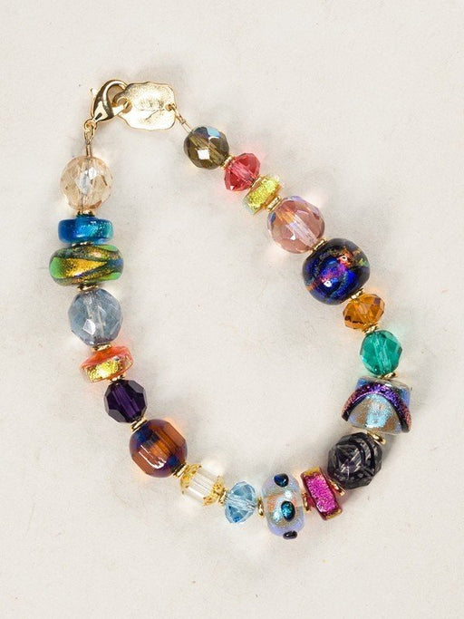 Our Coco Bracelet is a bead lover's dream, made up of a dazzling assortment of dichroic glass and European crystal. Each bead is individually chosen and strung by hand for a truly unique, one-of-a-kind keepsake piece.