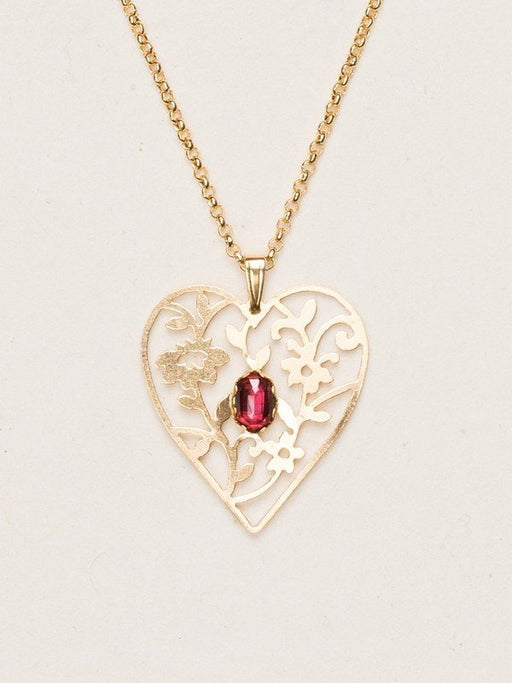 Our Blooming Heart Necklace is a work of tender beauty. The art of metal cutting is gorgeously displayed in this elaborate depiction of emerging springtime foliage, where a dazzling gemstone blooms brightly from the center.